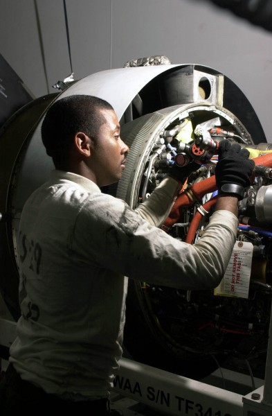 US Navy 030418-N-0413R-001 Aviation Machinist^rsquo,s Mate 2nd Class Isaac Sampson of Baltimore, Md., inspects the Turbo Fan Thirty Four (TF-34) jet engine of a S-3B Viking