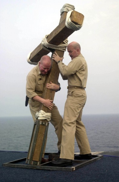 US Navy 030420-N-8273J-001 Chaplain Dan Reardon and Chaplain Kyle Fauntleroy work together to put up a crucifix for the Easter Sunrise Service on the flight deck of USS Nimitz (CVN 68)