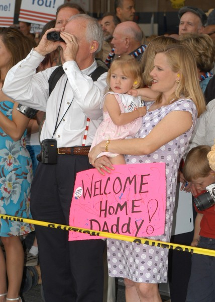 US Navy 030501-N-7032B-001 Family and friends eagerly await to welcome home sailors during the homecoming of Carrier Air Wing Fourteen (CVW-14) at Naval Air Station (NAS) Lemoore