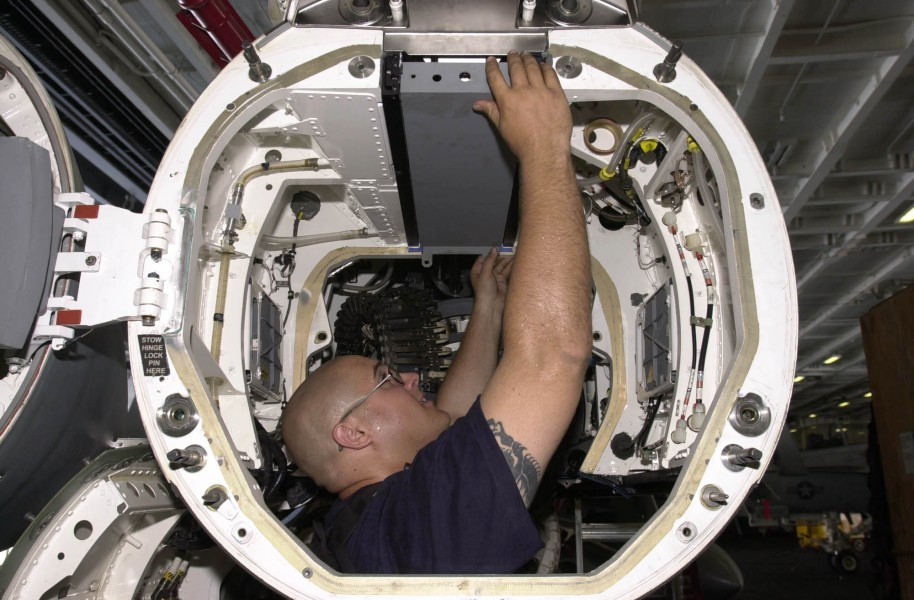 US Navy 030616-N-2143T-004 Aviation Electronics Technician 2nd Class James Gray from Bakersfield, Calif., works on an installation rack