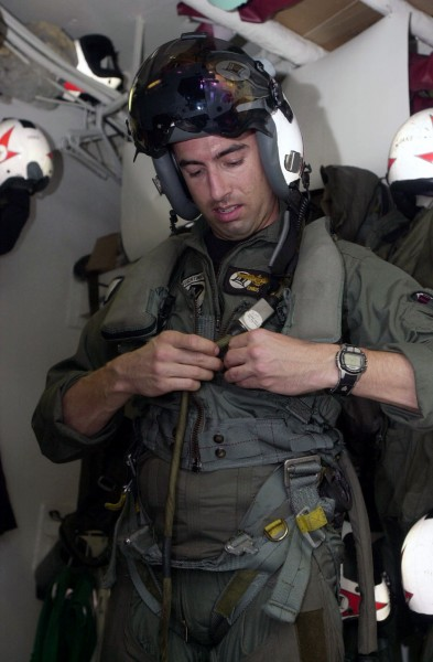 US Navy 030617-N-2385R-002 Lt. Christopher Papaioanu removes his flight gear in the paraloft aboard USS Nimitz (CVN 68)