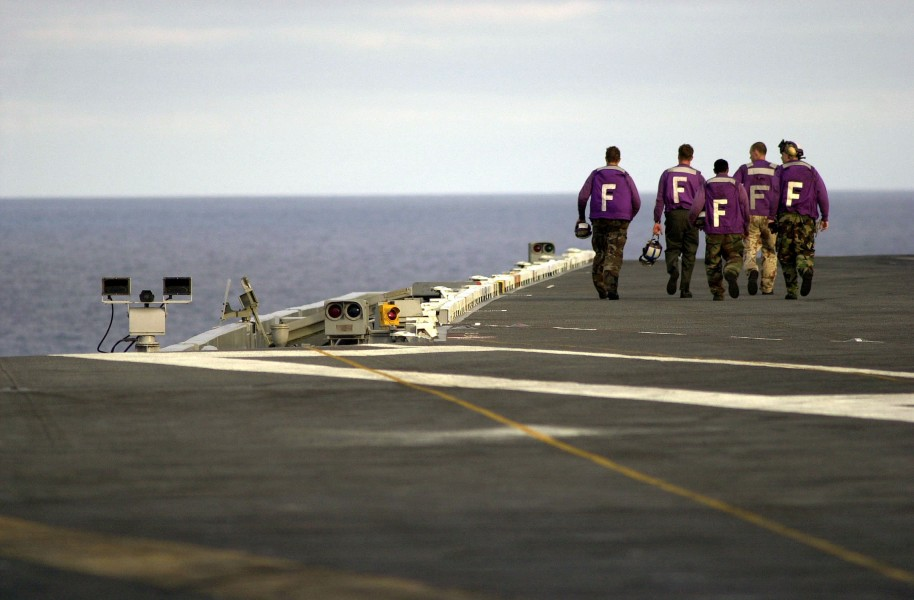US Navy 030731-N-6213R-204 Aviation Boatswain's Mates walk toward the bow of USS John C. Stennis (CVN 74) after a fueling evolution