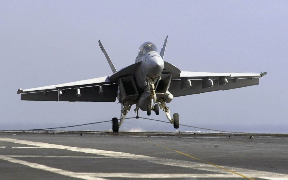US Navy 030807-N-6213R-171 An F-A-18F Super Hornet makes an arrested landing on the flight deck of USS John C. Stennis (CVN 74)