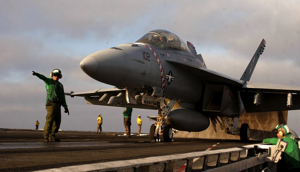 US Navy 030807-N-7732W-022 Flight deck personnel stand by to launch an F-A-18F Super Hornet