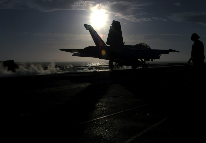 US Navy 030811-N-1573O-043 An F-A-18F Super Hornet launches from the flight deck aboard USS John C. Stennis (CVN 74)