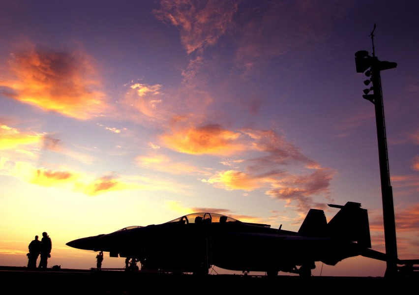 US Navy 030811-N-6213R-317 The sun sets behind an F-A-18F Super Hornet on the flight deck aboard USS John C. Stennis (CVN 74)