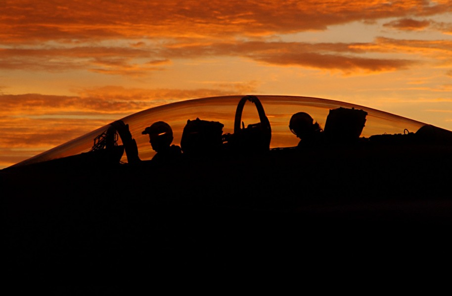 US Navy 030812-N-9769P-082 Silhouetted by a setting sun, the aircrew of an F-A-18F Super Hornet assigned to the