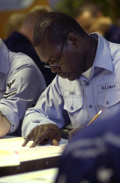 US Navy 030904-N-1577S-002 While taking the Navy 1st Class Petty Officer advancement exam aboard USS Nimitz (CVN 68), a sailor reviews a question before choosing an answer