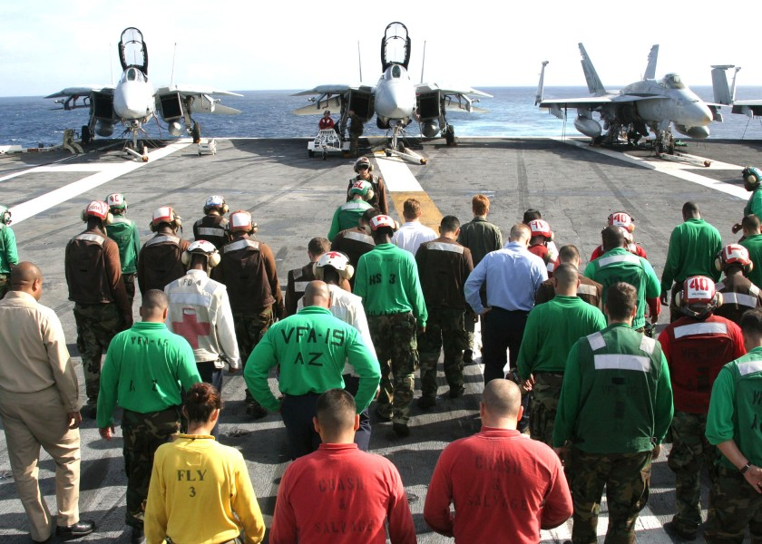 US Navy 030915-N-9907G-501 Crewmembers scour the flight deck during a Foreign Object Damage (FOD) walk down aboard USS Theodore Roosevelt (CVN 71)