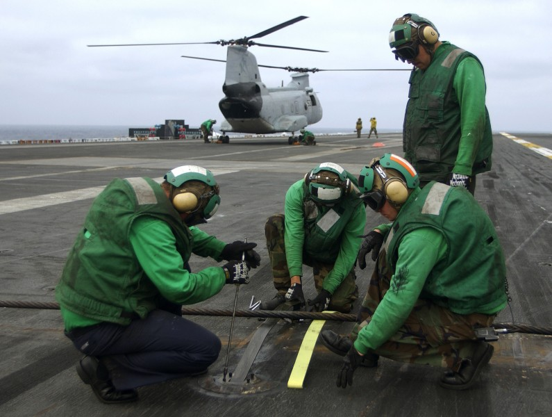 US Navy 030923-N-6213R-010 change arresting wire springs on the flight deck of USS John C. Stennis (CVN 74)