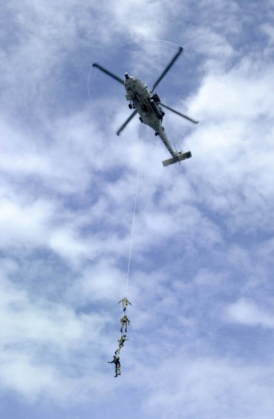 US Navy 031005-N-2385R-004 Explosive Ordnance Disposal Mobile Unit Eleven Detachment One (EODMU-11, DET 1) suspend themselves from a repelling rope