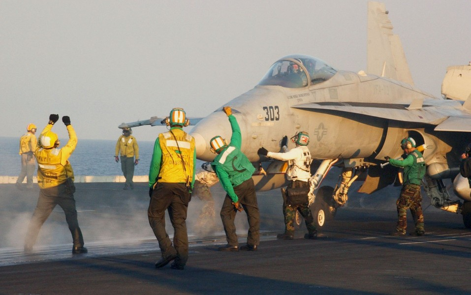US Navy 031028-N-7732W-124 Flight deck personnel perform final safety inspections prior to launching an F-A-18C Hornet