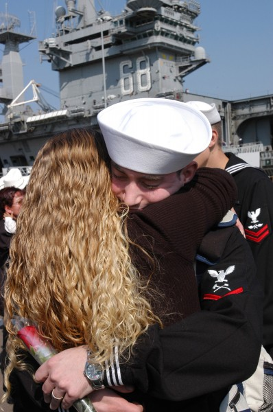 US Navy 031105-N-1356A-004 Damage Controlman 3rd Class Thomas Howard embraces his wife