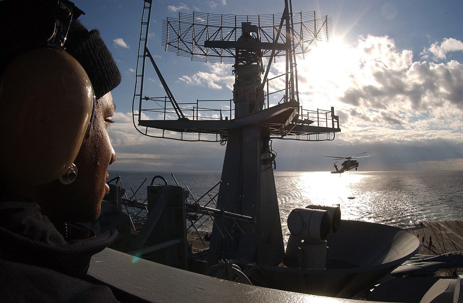 US Navy 031110-N-6278K-002 Seaman Okpara Kelly stands the aft lookout watch on the signal bridge aboard USS George Washington (CVN 73)