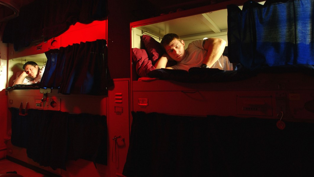 US Navy 031112-N-9769P-020 Sailors relax in their bunks