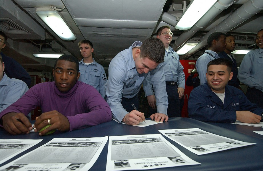 US Navy 031214-N-1045B-001 USS George Washington (CVN 73), Commanding Officer, Capt. Martin J. Erdossy, enjoys seeing Airman Craig Land, from Saucier, Miss., sign a