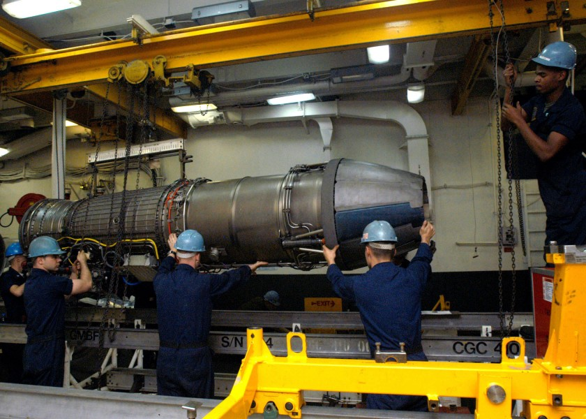 US Navy 040104-N-7278A-003 Personnel from the Aircraft Intermediate Maintenance Department (AIMD) prepare to place a jet engine onto an installation trailer aboard USS Enterprise (CVN 65)