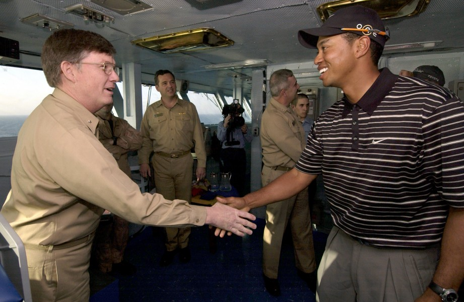 US Navy 040303-N-5319A-001 Tiger Woods meets Commander Carrier Group Eight (CCG-8) Rear Adm. Denby H. Starling II, on the flag bridge aboard the aircraft carrier USS George Washington (CVN 73)