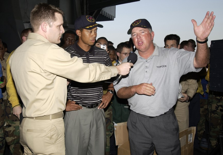 US Navy 040303-N-5319A-004 Professional golfers Tiger Woods and Mark O'Mara speak to the crew in the hanger bay of the nuclear powered aircraft carrier USS George Washington (CVN 73)