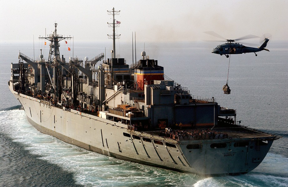 US Navy 040331-N-1045B-008 A MH-60S Knighthawk conducts a vertical replenishment at sea with the Military Sealift Command (MSC) fast combat support ship USNS Supply (T-AOE 6)