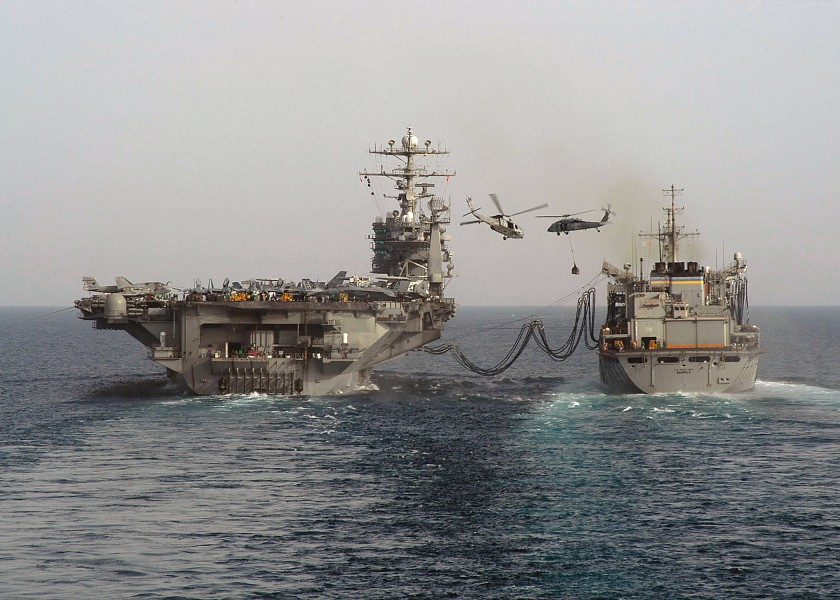 US Navy 040422-N-9630B-010 The Military Sealift Command (MSC) fast combat support ship USNS Supply (T-AOE 6) and USS George Washington (CVN 73) perform a connected replenishment at sea (RAS)