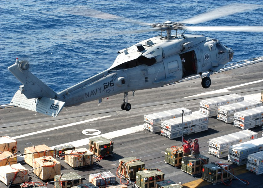 US Navy 040423-N-7408M-004 An SH-60F Seahawk hovers just above the flight deck of USS Enterprise (CVN 65)