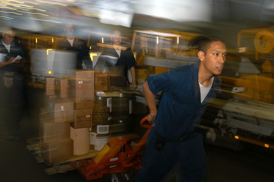 US Navy 040506-N-9047Q-002 Airman Michael Munoz moves Hazardous Material (HAZMAT) items through the hangar bay