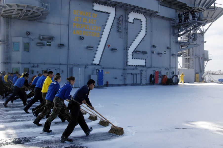US Navy 040603-N-9593M-067 USS Abraham Lincoln (CVN 72) Aviation Boatswain's Mates perform a flight deck scrub following a counter-measures wash down test on the ship^rsquo,s flight deck