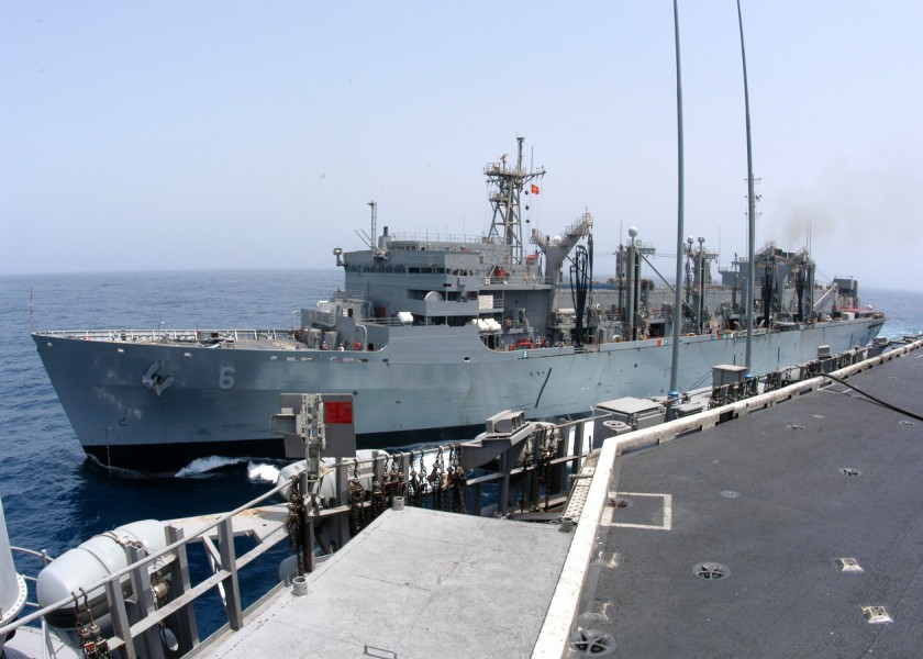 US Navy 040706-N-7695R-001 USS John F. Kennedy CV 67 pulls alongside the Military Sealift Command ship USNS Supply T-AOE 6 during Replenishment at Sea RAS