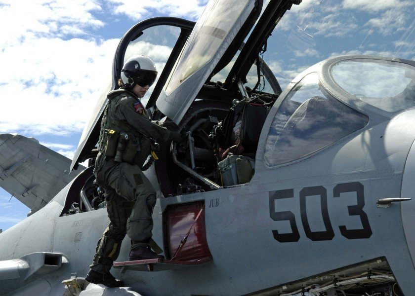 US Navy 041026-N-0499M-024 An Electronic Countermeasures Officer (ECMO) climbs into her EA-6B Prowler assigned to the Lancers of Electronic Attack Squadron One Three One (VAQ-131)