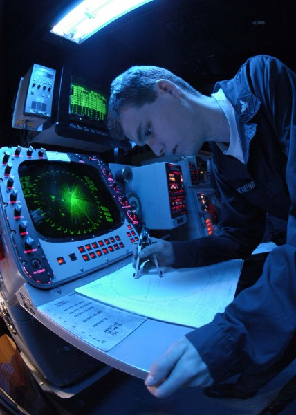 US Navy 041026-N-5362F-016 Operations Specialist 3rd class Jon Morgantini of Santa Barbra, Calif., uses the SPA-25 surface radar aboard USS Abraham Lincoln (CVN 72) to plot surface contacts
