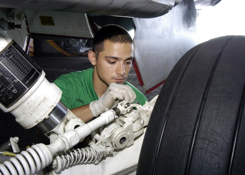 US Navy 041117-N-7816R-012 Aviation Structural Mechanic 3rd Class Jimenez Jorge of Houston, Texas, paints the landing gear assembly on an F-A-18E Super Hornet