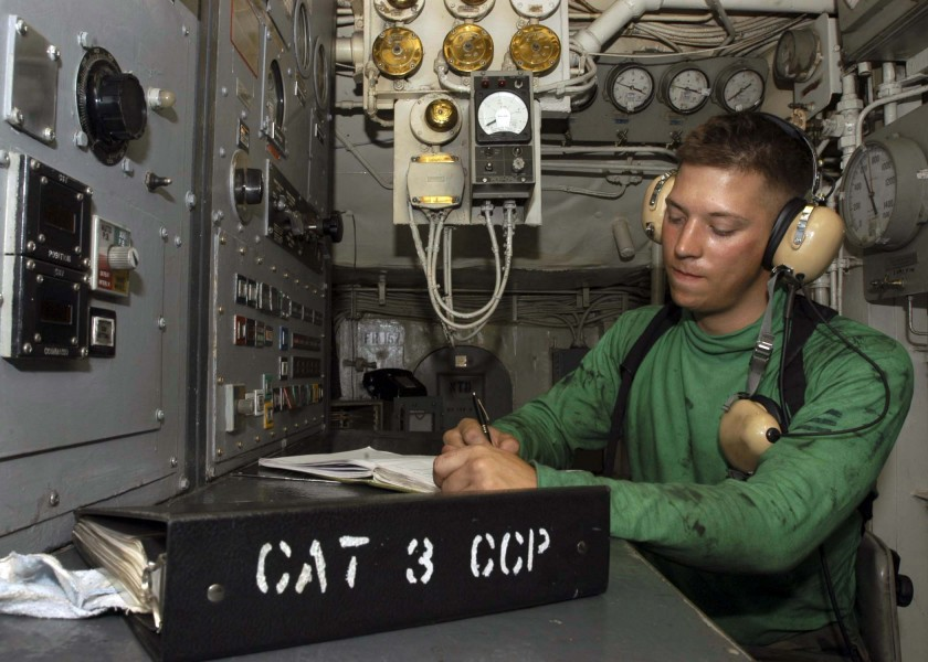 US Navy 041117-N-9079D-073 Airman Matt Rommel logs catapult shot numbers for Catapult Three in the Rotary Room aboard the Nimitz-class aircraft carrier USS Abraham Lincoln (CVN 72)