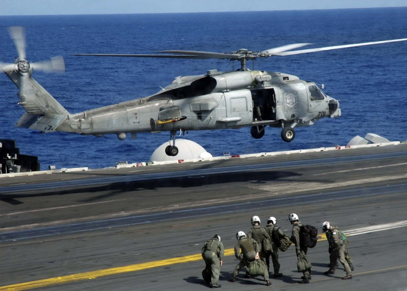 US Navy 041117-N-9293K-251 A SH-60B Seahawk repares to land aboard the Nimitz-class aircraft carrier USS Abraham Lincoln (CVN 72)
