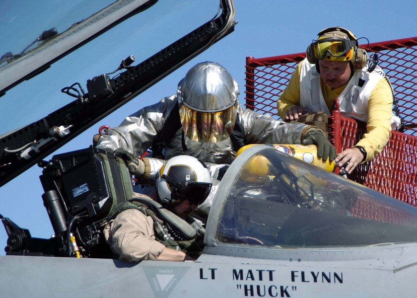 US Navy 041118-N-0057P-063 Firefighters remove the pilot of an F-A-18C Hornet during an aircraft fire training exercise on the flight deck aboard the Nimitz-class aircraft carrier USS Abraham Lincoln (CVN 72)