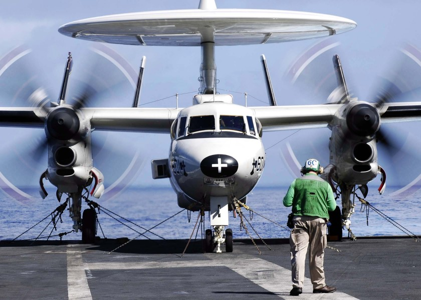 US Navy 041207-N-4166B-049 An E-2C Hawkeye places engines in full military aboard the Nimitz-class aircraft carrier USS Abraham Lincoln (CVN 72) prior to flight operations