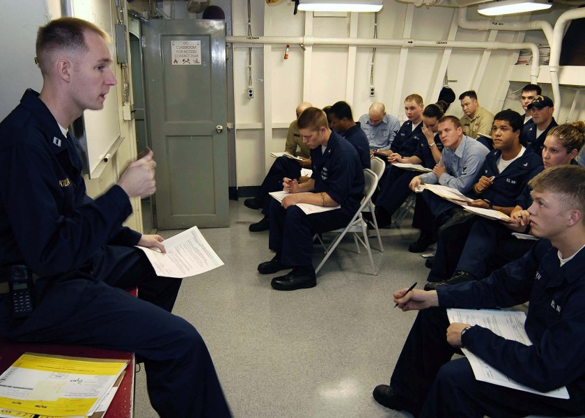 US Navy 050101-N-4166B-033 Lt. Jeremy Kilday conducts a health brief for sailors aboard USS Abraham Lincoln (CVN 72)