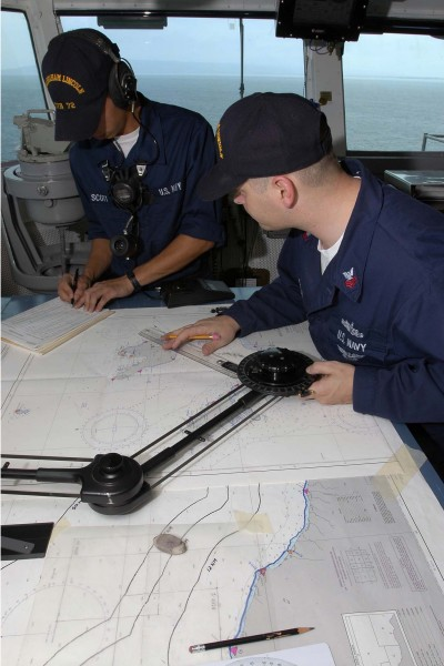 US Navy 050101-N-6074Y-042 Crew members plot the ships course for USS Abraham Lincoln (CVN-72) as she transits the waters off of the coast of Banda Aceh, Sumatra, Indonesia
