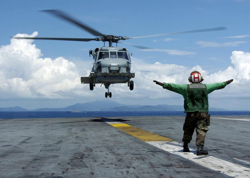 US Navy 050110-N-6817C-056 A Landing Signals Enlisted man directs an SH-60B Seahawk helicopter, assigned to the Saberhawks of Helicopter Anti-Submarine Squadron Light Four Seven (HSL-47)