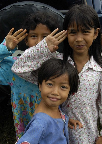 US Navy 050119-N-9951E-067 Young girls salute in their best form for a photo taken at one of the camps located in the town of Alue Bilie, Aceh, for civilians displaced by the Dec. 26 tsunami