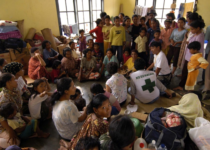 US Navy 050119-N-9951E-109 Representatives from the United Nations (UN) and the World Health Organization (WHO) converse with Indonesian nationals living at a camp located in the town of Alue Bilie, Aceh