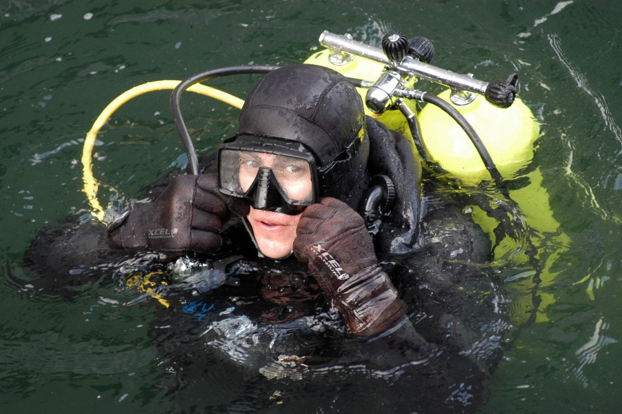 US Navy 050202-N-3390M-269 Operations Specialist 2nd Class Mathew Medeiros checks his goggles during diving proficiency training on board Naval Station Everett