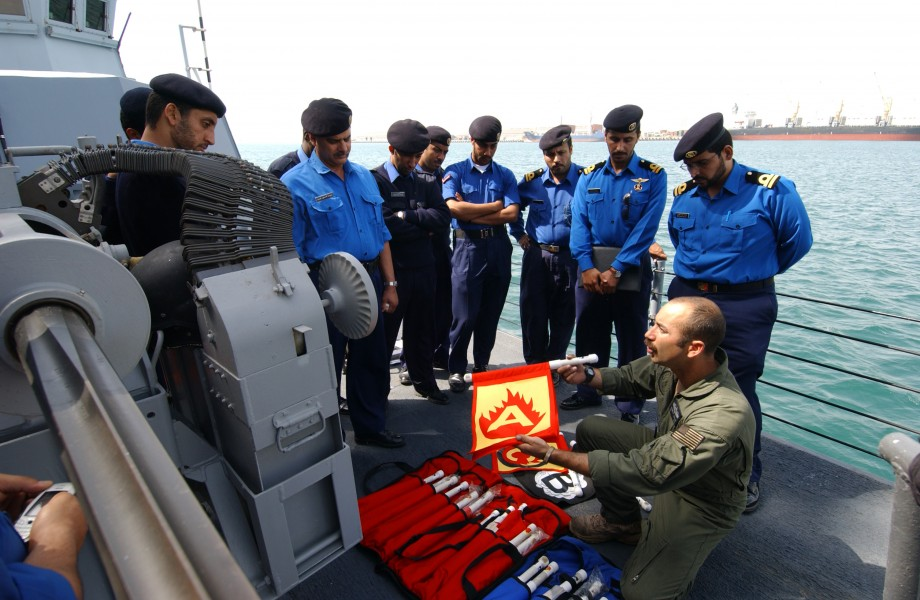 US Navy 050404-N-5526M-009 Damage Controlman 1st Class Kenneth Gibson instructs Qatari Sailors on damage control aboard the Cyclone-class patrol coastal boat USS Chinook (PC 9)