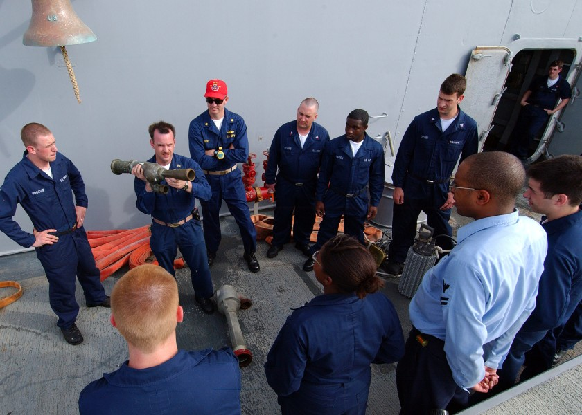 US Navy 050503-N-5526M-001 Chief Damage Controlman Sean Mahoney from Phoenix, Ariz., assigned to the Ticonderoga-class guided missile cruiser USS Normandy (CG 60), gives repair locker training