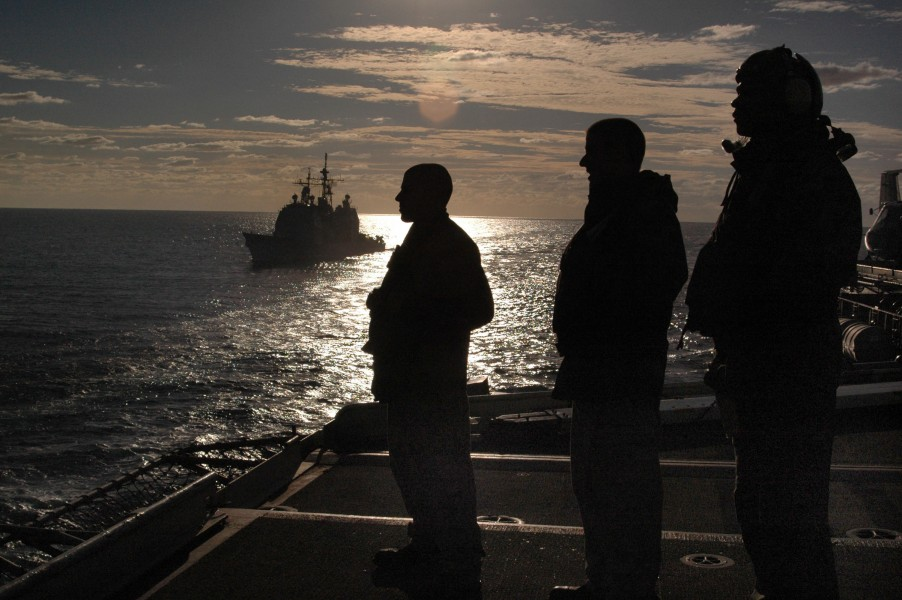 US Navy 050617-N-9551Z-079 Sailors observe a replenishment at sea from the flight deck aboard the conventionally powered aircraft carrier USS Kitty Hawk (CV 63)