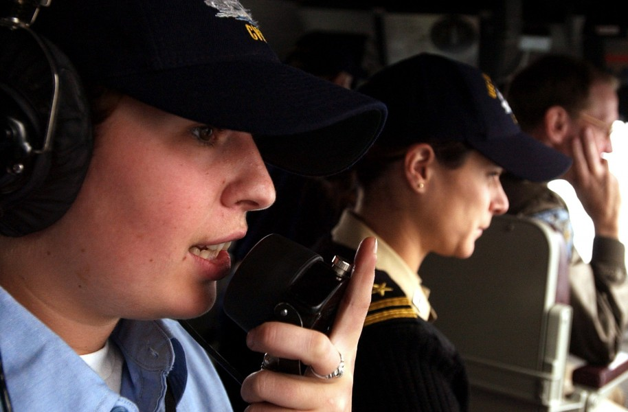 US Navy 050726-N-5549O-097 Station to station phone talker, Seaman Ariane Ellis, left, communicates with the guided-missile destroyer USS Decatur (DDG 73)