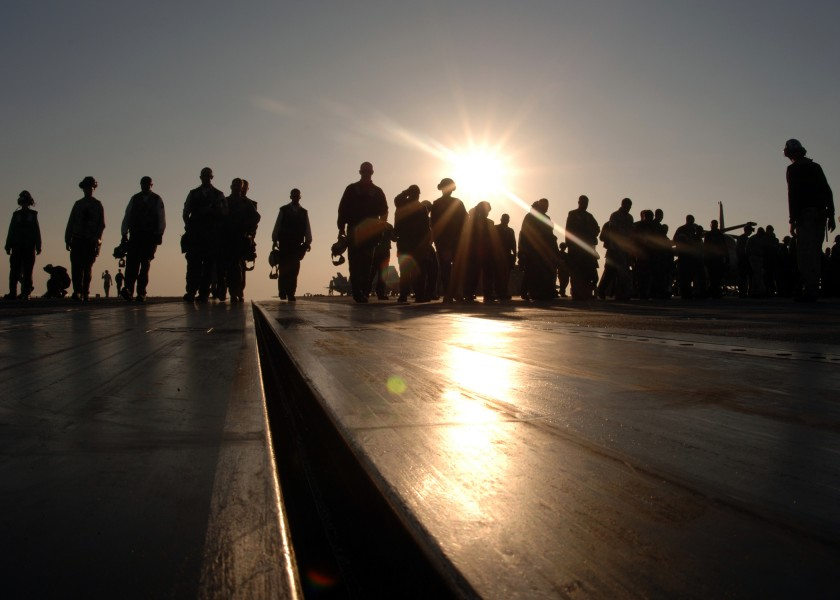 US Navy 051204-N-2838C-005 Air Department and squadron personnel perform a foreign object damage (FOD) walkdown on the flight deck aboard the Nimitz-class aircraft carrier USS Theodore Roosevelt (CVN 71)
