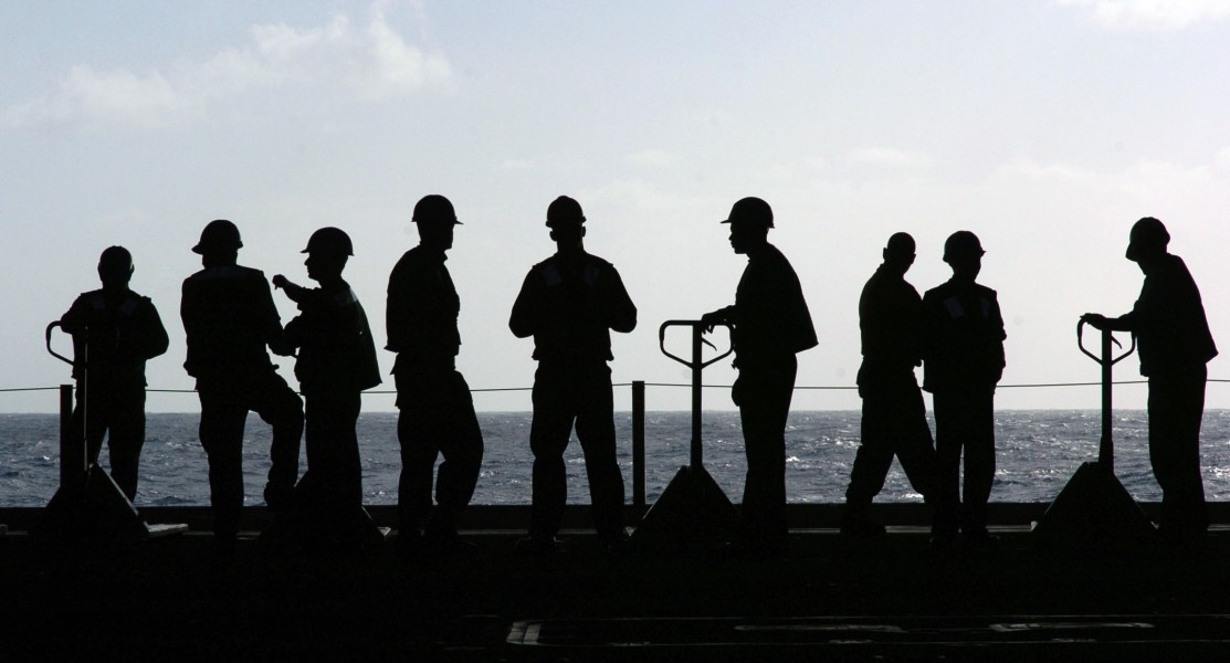 US Navy 060113-N-7130B-127 Sailors aboard the Nimitz-class aircraft carrier USS Ronald Reagan (CVN 76) wait for the next load of stores to be transported from the flight deck to the hangar bay