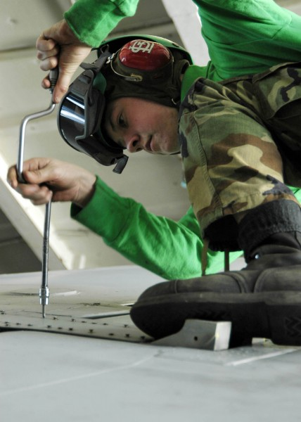 US Navy 060115-N-7981E-015 Airman Jake Edinger conducts repairs on the wing of an EA-6B Prowler assigned to the Lancers of Electronic Attack Squadron One Three One (VAQ-131)