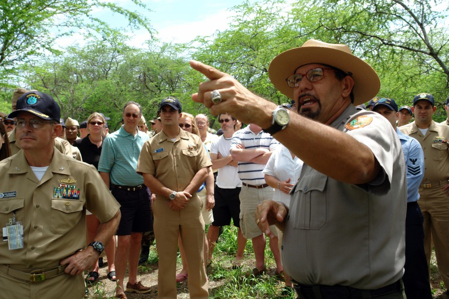 US Navy 060316-N-9643K-001 National Park Service Ranger Daniel Martinez addresses a group of Sailors from the Pearl Harbor Surface Navy Association (SNA) at the site of the USS Arizona relics